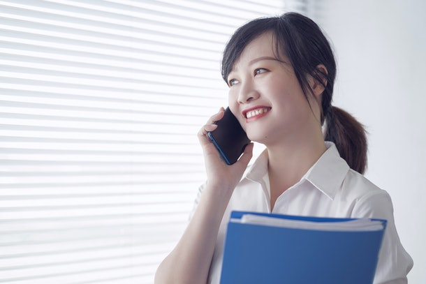 an office woman is calling