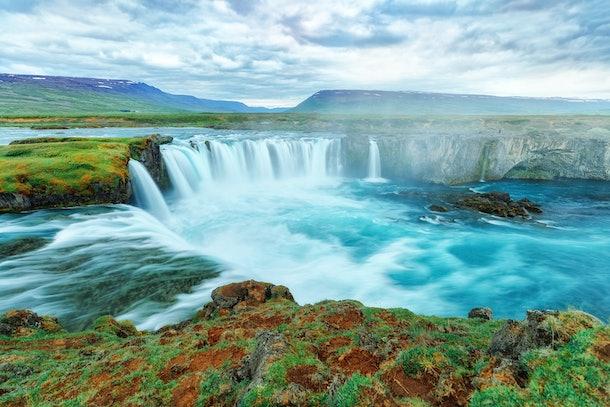 Godafoss waterfall, Iceland. Amazing long exposure scenery of famous landmark in Iceland - waterfall Godafoss. Popular tourist landmark, travel destination in Iceland.