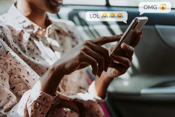 Black woman texting in a car
