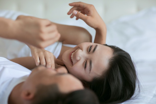 Young asian couple sleeping on bed.