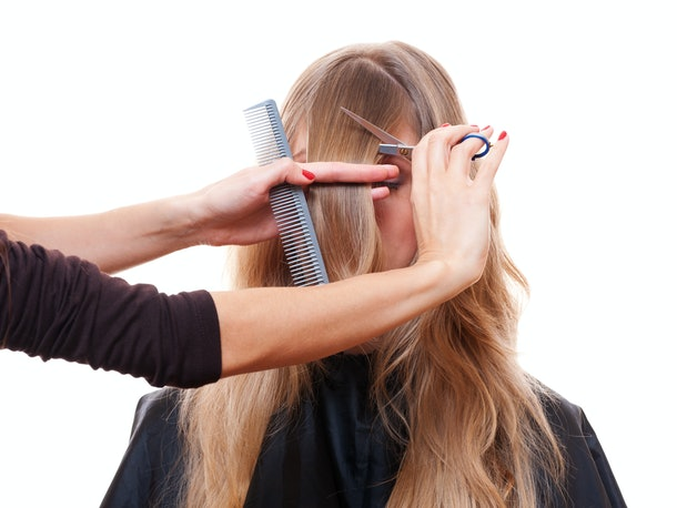 hairdresser cutting models fringe. isolated on white background