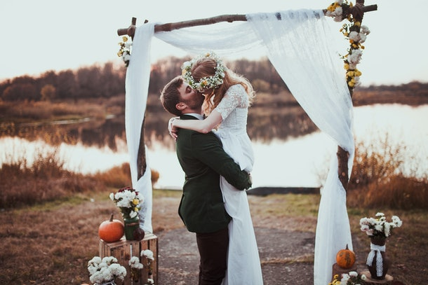 bride and groom on wedding ceremony on rustic autumn wedding