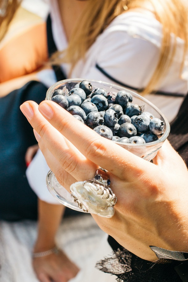 Woman offers freshly picked blueberries