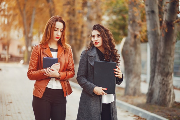 Girls are walking. Girls on the street. Beautiful girlі with computer