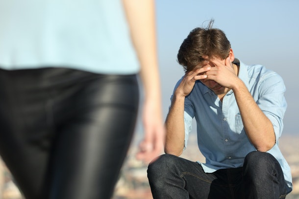 Sad man complaining outdoors after break up. Girlfriend leaving him