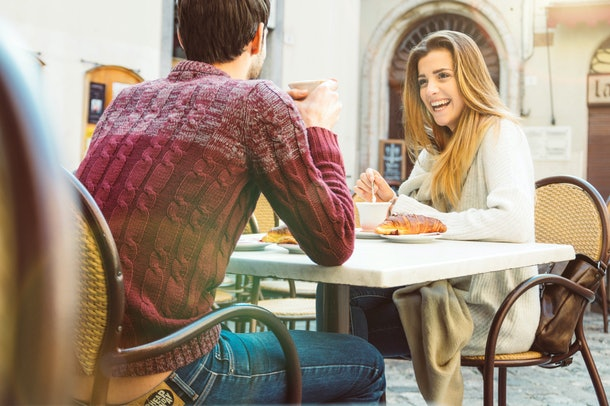 Couple dating at restaurant drinking coffee having fun and smiling
