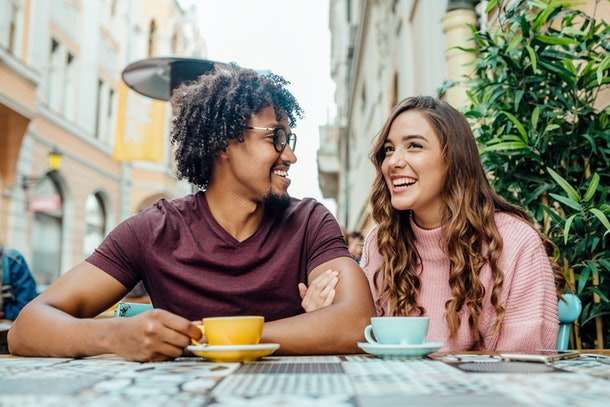 Young couple having a date in cafe