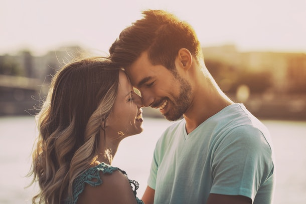 Young happy couple enjoys spending time outdoor together.Happy couple Image is intentionally toned.
