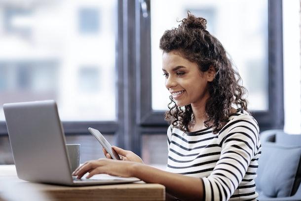 Beautiful girl working on her laptop