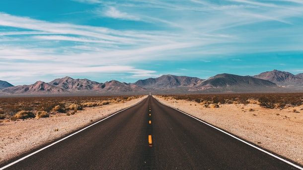 Open road with mountains on the horizon