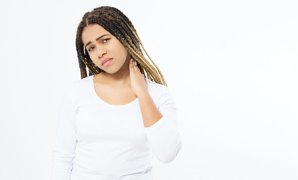 Tired black girl having pan in neck, Moody young woman holding her neck