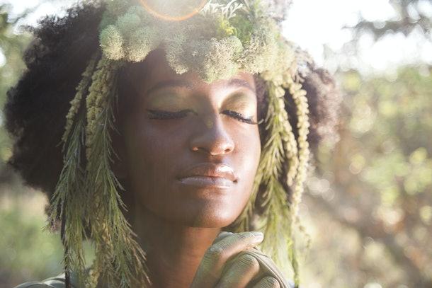 Beautiful woman as a forest goddess with faun headdress.