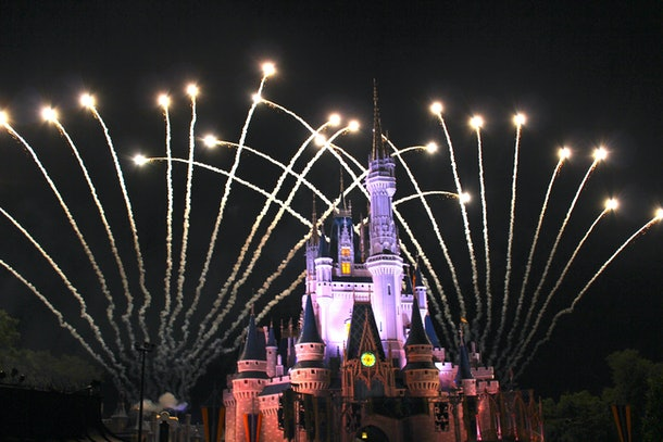 Disney's Cinderella castle at night during the fireworks show.
