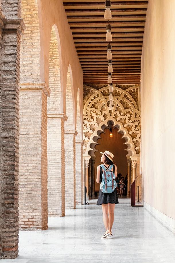 Woman traveler at the Aljaferia, one of the most famous places in Zaragoza. Moorish Islamic palace in mudejar architectural style