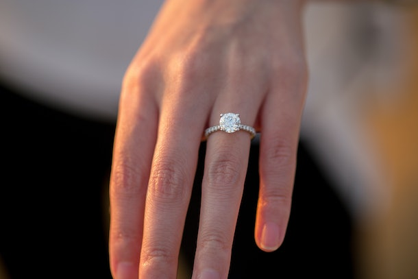 A newly engaged person shows off her ring.