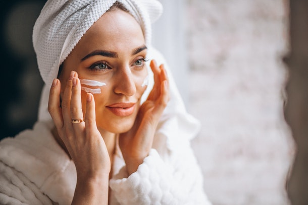 Woman applying face cream