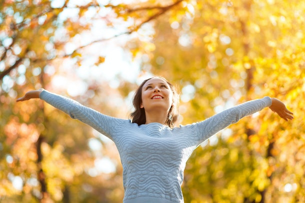 happy girl enjoying life and freedom in the autumn on the nature. autumn concept