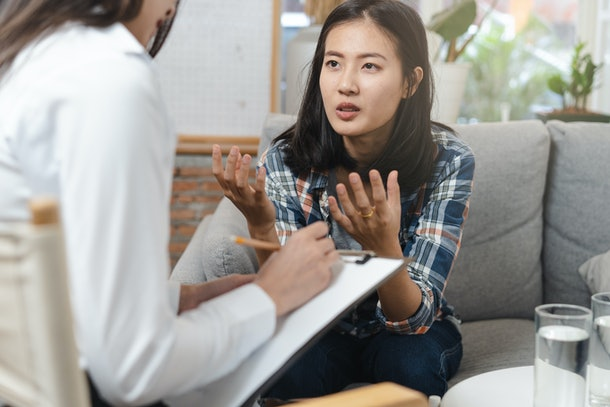 psychologist talking with depressed patient about mental condition.