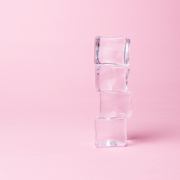 Creative layout of ice cubes on pastel pink background. Minimal summer concept. Flat lay.