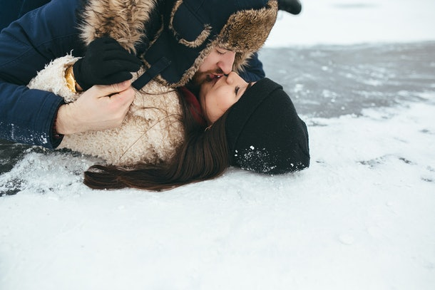 man and woman kiss on the ice, close view