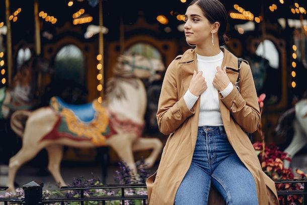 girl walking through the amusement park in paris