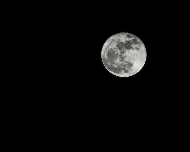 full moon on black background