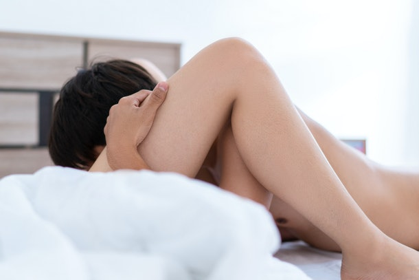 Close up of passionate young asian couple having sex on bed.