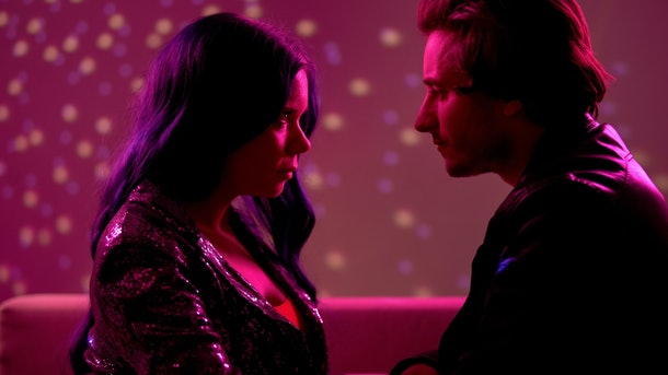 Young couple looking seductively at each other in night club, passion and flirt