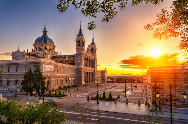 Sunset view of Madrid Cathedral Santa Maria la Real de La Almudena in Madrid, Spain. Architecture and landmark of Madrid. Night cityscape of Madrid