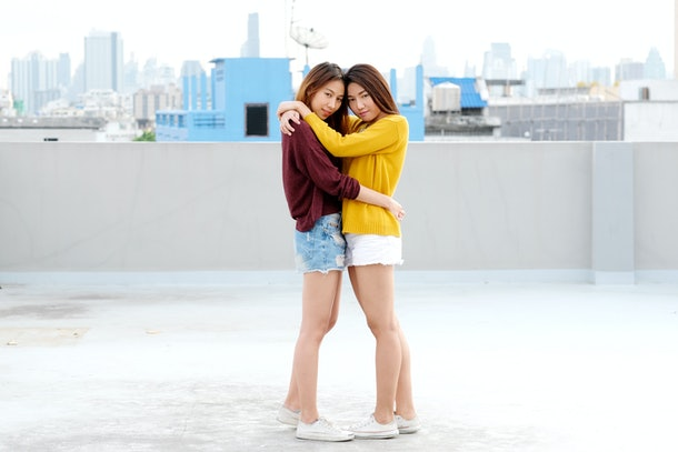 LGBT, Young cute asia lesbian couple huging and smiling with happiness on their dating, homosexual, lesbian couple happy moment, diversity lifestyle