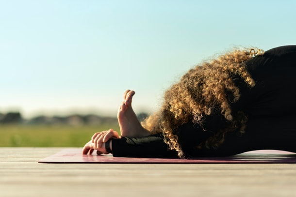 woman doing yoga exercise away from city life