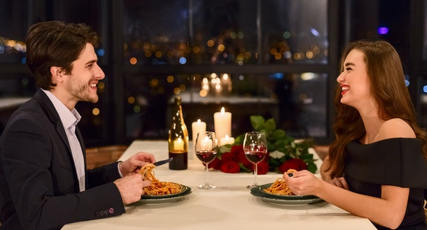 Loving couple in a restaurant having dinner, drinking wine., celebrating Valentine day