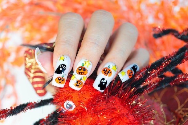 cute lovely orange pumpkin and little black ghost painting on fashionista woman acrylic fingernail,gel nail design for Halloween
