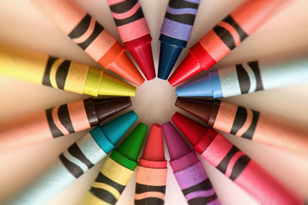 Crayons color pencils circular abstract background and art