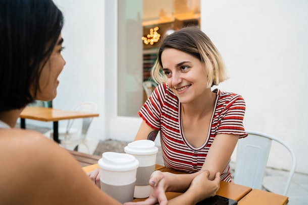 A lesbian couple has a romantic coffee date in the city on Valentine's Day.