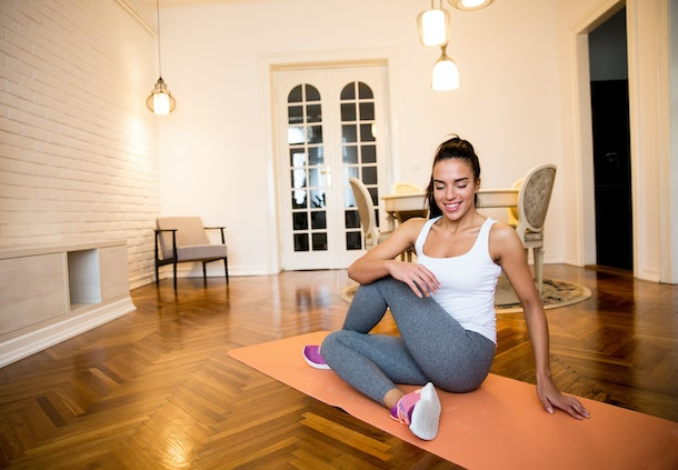 Fit woman exsercise in the room at home