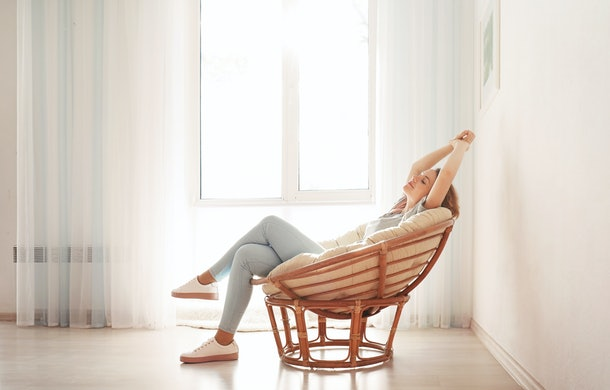Happy young woman relaxing at home