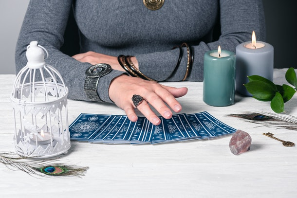Fortune teller reading future by tarot cards concept.