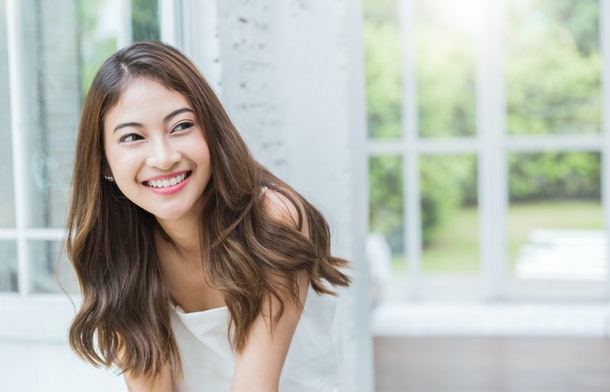 Portrait of young beautiful asian sexy woman relax at home in spring or summer. Smile happy asian girl with perfect clear glow skin face. Asia lifestyle people education beauty girl next door concept.