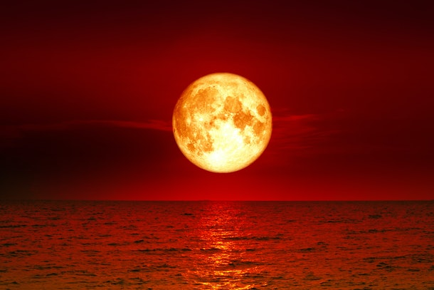 super full blood moon  and moon light over river , Elements of this image furnished by NASA