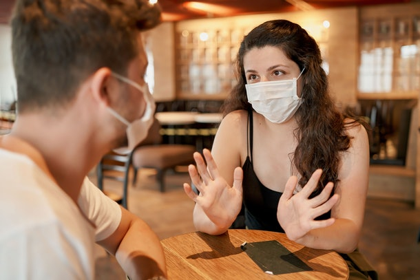 Wearing a mask on a date? The key to feeling confident is to maintain your sense of humor about the situation.