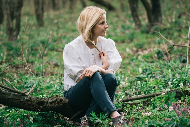Daydreamer woman relaxing in forest