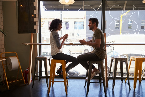 Couple Meeting For Date In Coffee Shop